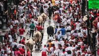 Bull-run survival author gored in Pamplona festival