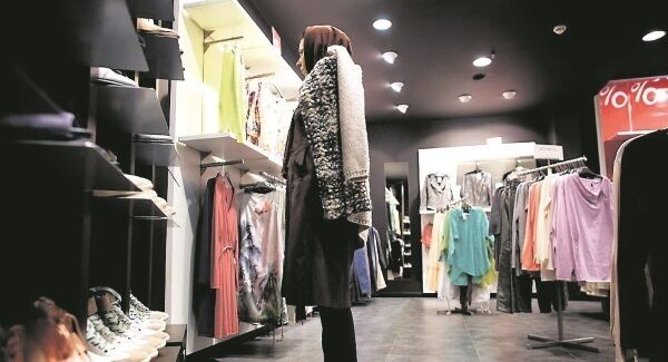 An Iranian woman shops in the northern Elahieh neighbourhood of Tehran. Morewestern fashions are becoming available in the city. Picture: Getty