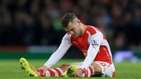 Wilshere out for three months after ankle surgery