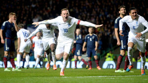 Rooney double silences Scotland