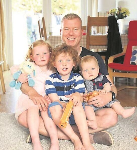 John Owens, pictures with his children Jacob, 5, Teagan, 3, and Benjamin, 1, at thier home in Cabinteely, Co Dublin