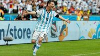 Argentina's blushes spared by Messi magic