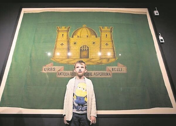 On Good Friday 1916, Adam Windrim's grandfather Sam was to assist the landing of German guns and drove from Limerick to Kerry, where this flag — on loan to the Limerick City Hall 1916 exhibition — was seized from Casement when arrested. Picture: Sean Curtin