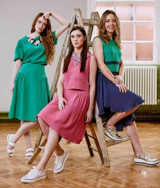 L-R: Maria wears Manley Cara suede tee, €220, Cori skirt, €250, and Cori necklace, €179; sandals, €70, Buffalo. Caroline wears Manley Lana top, €150, Cori skirt, €250, and Boxter collar, €199; SixtySeven shoes, €89, Buffalo. Emma wears Manley Lana top, €150, and Cara skirt, €299; shoes from Buffalo.