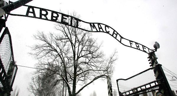 The entrance gates to Auschwitz concentration camp. 'Arbeit macht frei' translates to 'work will set you free'