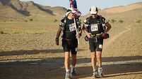 Ranulph Fiennes digs in to complete ultra marathon in desert