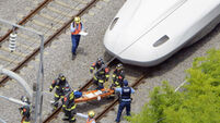 Japan seeks motive for train suicide