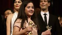Dissident Iranian director scoops top film award