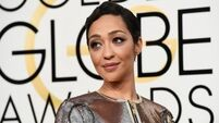 Ruth Negga lights up the red carpet with gold dress at the Golden Globes
