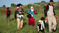 Refugees try to beat Hungary crackdown