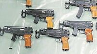 UK police arrest seven people in weapons raid