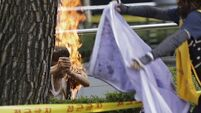 Japan protester, 80, sets self on fire