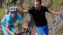 Vincenzo Nibali celebrates but Chris Froome not impressed