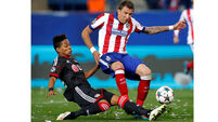 Atletico squeak past Leverkusen