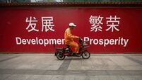 Chinese economy grows but warning signs still persist