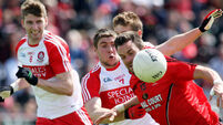 Eoin Bradley drags nervy Derry over the line