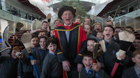 Cody accepts honorary DCU doctorate