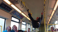 VIDEO: Irish lad performs pull-up stunt on the Dart