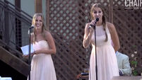 Bridesmaids belt out surprise medley at sister's wedding