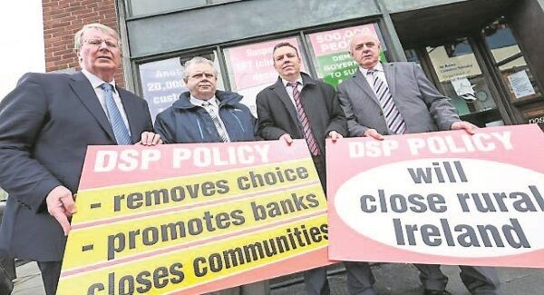 Irish Postmasters' Union general secretary Ned O'Hara, left, with IPU officers at a protest at the Department of Social Protection.