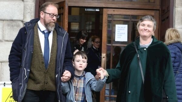 Iarlaith leaving the Four Courts today with his parents, Fiachra and Deborah.