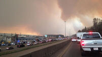 Over 80,000 forced to flee wildfire in Canada