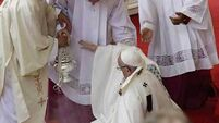 Pope Francis falls as he says Mass in Poland