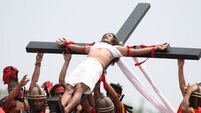 Devotee in the Philippines nailed to cross