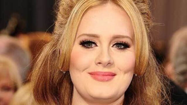 Adele 'angry and upset' after hacked pictures go online