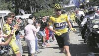 Tour de France: Road runner Chris Froome stays in yellow on day of drama