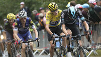 Chris Froome bloodied but unbowed in thrilling stage