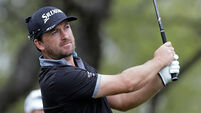 Jason Day plays through the pain to edge frustrated Graeme McDowell