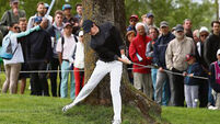 Thongchai Jaidee keeps Rory McIlroy at bay