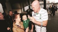 Rugby fans high five their heroes as Irish team arrives home to Dublin