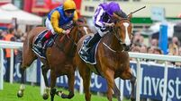 Minding overcomes trouble to land Investec Oaks at Epsom