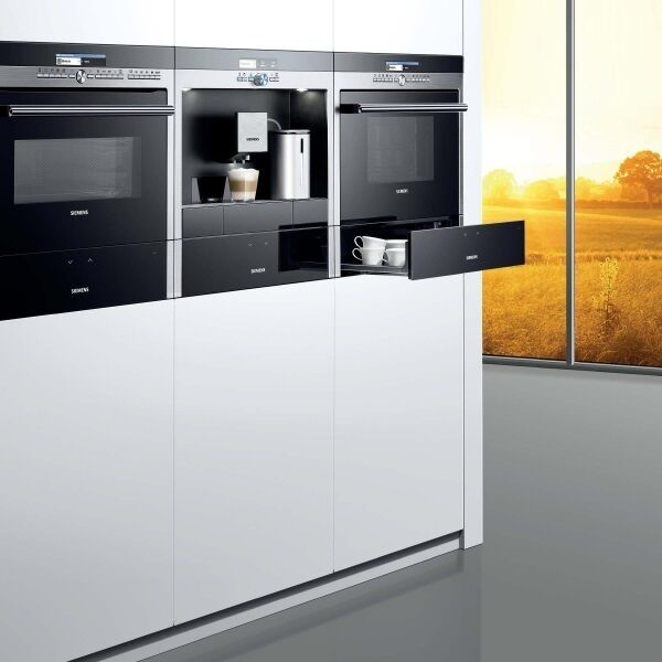 Fabulous form and function doesn?t come much better than a built in coffee centre with espresso loving SensoFlow, framed by 1Q700 warming drawers and ovens from Siemens. Match these sleek contenders priced integrated from ?630 for a microwave (BF634LGS1B) to the Siemens Touch Slider induction hobs from ?699 (CT636LES1). Even at this level of spend, don?t forget the essential wisdom of the golden triangle. Layout your kitchen with the shortest walk between your fridge, cooker and sink. Siemens.com
