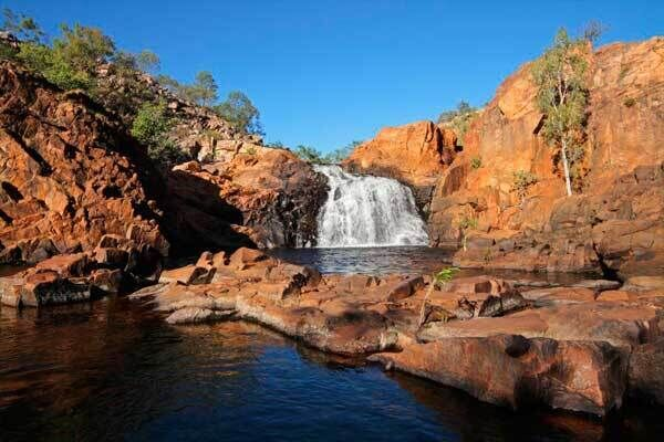 A small waterfall and pool with clear water, at Kakadu National Park