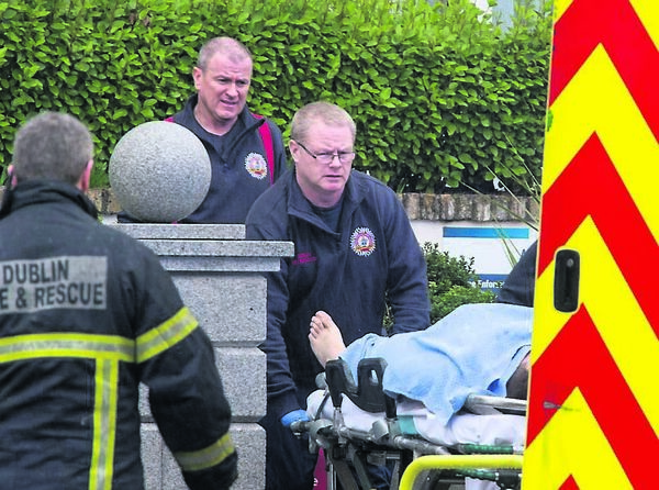 The scene after the shootings at the Regency Hotel on Friday afternoon as paramedics remove a man injured in the attack. Picture: Cascadenews.co.uk