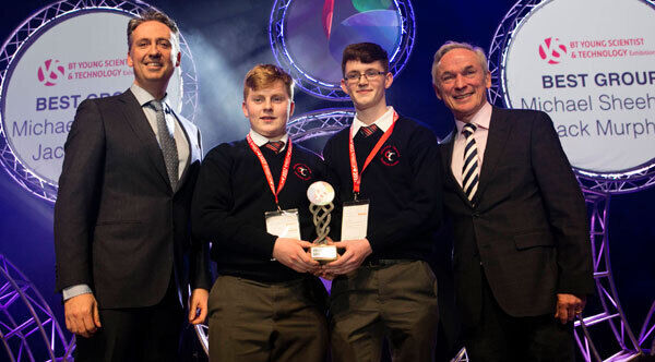 Shay Walsh, Managing Director BT Ireland and Minister for Education and Skills Richard Bruton TD present the Best Group Award to Michael Sheehan and Jack Murphy from Colaiste Treasa Cork.
