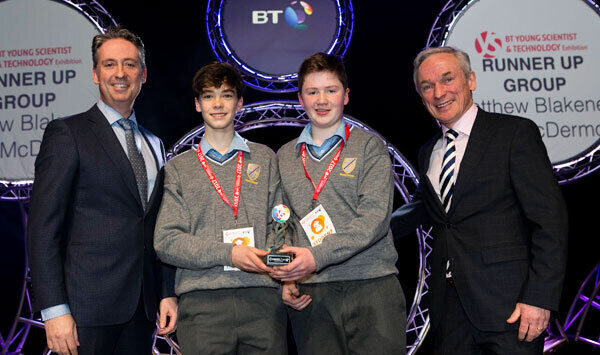 Shay Walsh, Managing Director BT Ireland and Minister for Education and Skills Richard Bruton TD present the Runner Up Group Award to Matthew Blakeney and Mark Mc Dermott from Jesus & Mary Secondary School, Sligo.