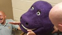 Teen gets trapped in a Barney head and has to go to the Fire Dept for help