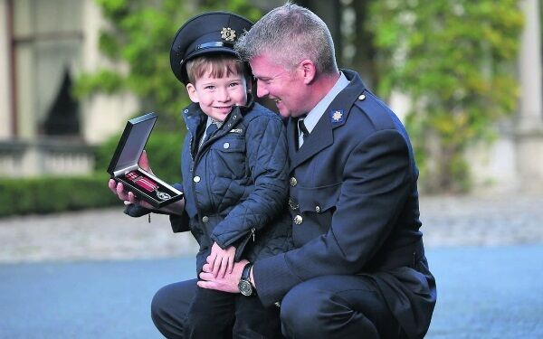 Garda Michael Twomey, from Cork , with his five-year-old son Ryan at the National Bravery Awards. Garda Twomey was awarded a medal for intercepting a gang of armed raiders. Picture: Julien Behal