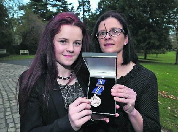 Bronze bravery medal recipient, 14-year-old Kerri Brosnan from Midleton, Cork, with her mother, Mary. Picture: Colin Keegan
