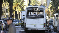 Islamic State claims Tunisia bus attack, body of suspected bomber found