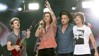 One Direction 'will be back' from one-year break