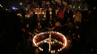 Belgians demonstrate solidarity with Paris at candlelight vigil in Molenbeek