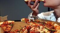 QUIRKY WORLD ... Pizza addict thrown out of hospital vows to shed flab