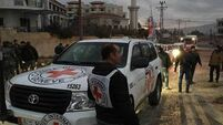 Convoys deliver aid to besieged Syria towns for second time this week