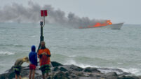 60 escape after tourist boat goes up in flames off New Zealand coast