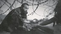 Press photo award for 'haunting' image of migrants